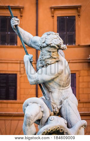 Close up portrait of God Neptune statue. Fountain of Neptune at the northern end of Navona Square /Piazza Navona/ in Rome Italy.