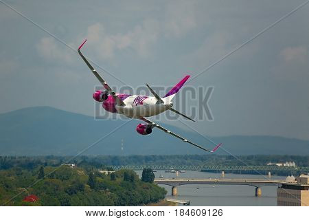 BUDAPEST, HUNGARY - MAY 1, 2014: Wizzair Airbus A320 performing a low pass over river Danube as part of the May 1 celebration.