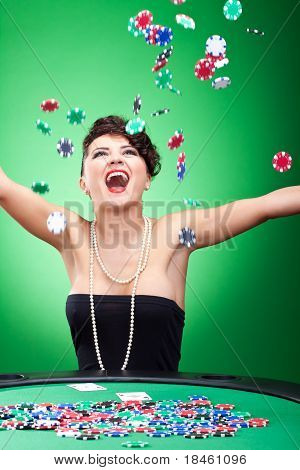 very happy casion lady winning and throwing chips in the air poster