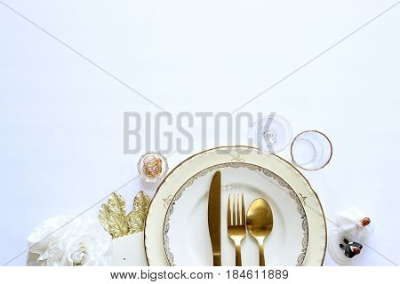 Wedding reception dishes and decorations frame white open copy space.