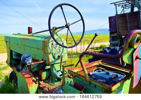 April 12, 2017 in Carrizo Plain, CA:  Haunting image of forgotten abandoned farming equipment on rural prairie grasslands taken in the Carrizo Plain, CA where visitors can see rural untouched grasslands and vintage tractors at abandoned ranches