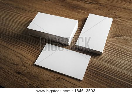 Photo of blank business cards. Blank business cards on wooden table background. Template for ID. Mockup for branding identity.