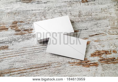 Photo of blank business cards on vintage wooden floor background. Template for your design.