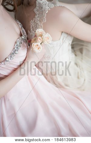 Blurred image in pink beige pastel colors background two tender girls models in Veil Wedding Dress. Boudoir photography. Selective focus. High key