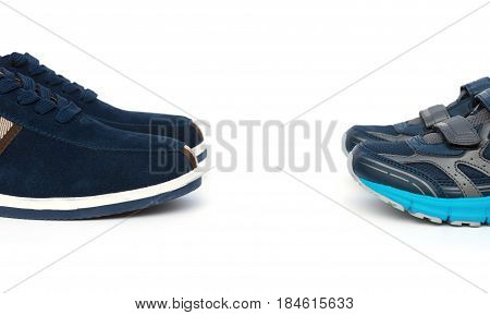 two pairs of shoes for men and kids on white background family concept