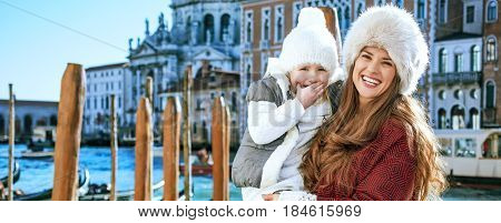 Happy Mother And Daughter Tourists In Venice, Italy In Winter