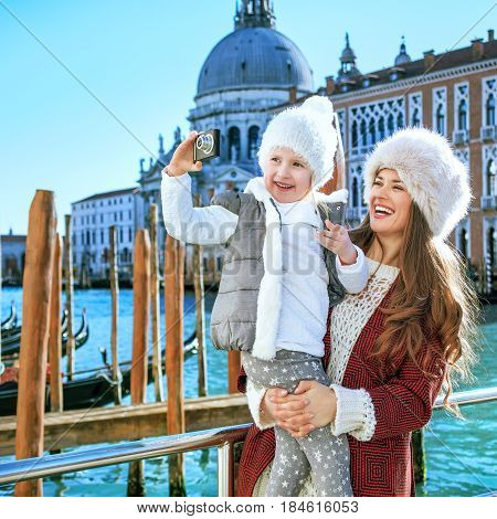 Mother And Child In Venice Taking Photo With Digital Camera