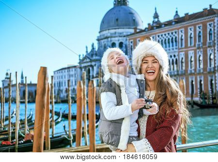 Mother And Child Travellers In Venice With Digital Photo Camera