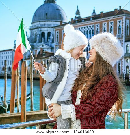Mother And Child Travellers In Venice, Italy With Italian Flag