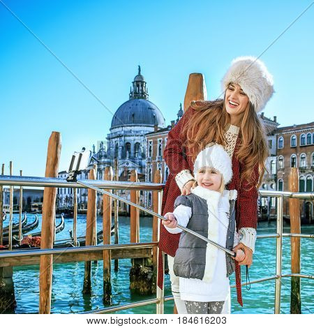 Mother And Child In Venice Taking Selfie Using Selfie Stick