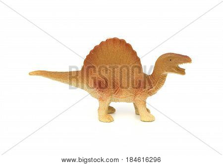 side view brown spinosaurus toy on a white background