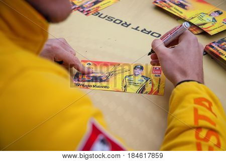 Moscow, Russia - 12 June 2016: world championship WTCC at the Moscow Raceway. The driver of the team's Lada Sport Rosneft Hugo Valente autographs