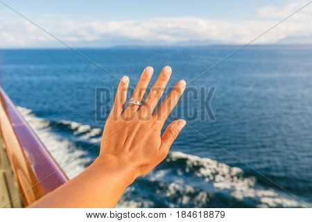 Woman showing new wedding ring hand on newlyweds honeymoon cruise travel taking selfie on holidays. Engagement ring and wedding band. Luxury vacations.