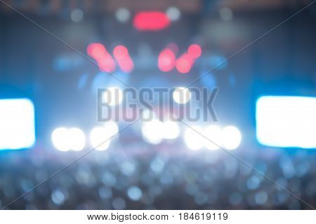 light in stage. Background image with defocused blurred stage lights. cheering crowd at concert