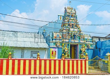 The scenic facade of the Hindu Temple dedicated to Lord Shiva decorated with numerous sculptures reliefs and patterns Galle Sri Lanka.