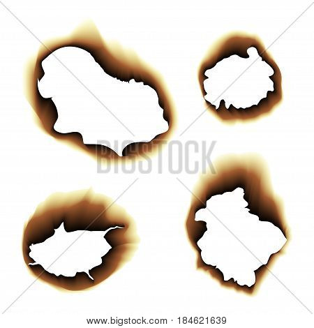 Scorched holes in the paper. Burned paper holes on a white background. Burnt scorched paper hole.