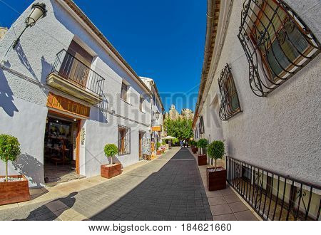 GUADALEST, SPAIN - 06 November 2016: Touristic Street with Souvenir Shops of Guadalest town in Alicante Province, Spain