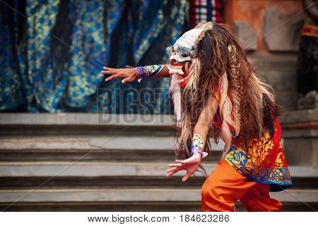 Dancer in demon Rangda traditional mask - evil spirit of Bali isalnd. Temple ritual dance at ceremony before Balinese silence day Nyepi. Religious festivals art ethnic culture of Indonesian people.