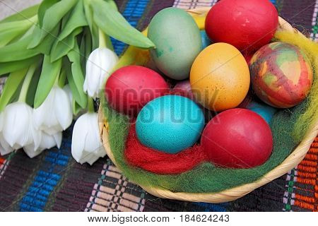 Close up of colorful painted easter eggs in a basket