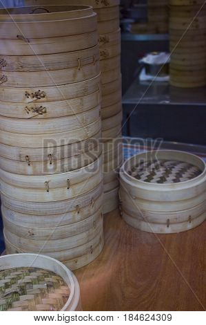 Some stacks of traditional wooden bamboo steamers.