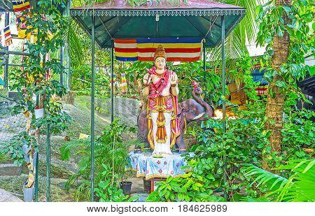The Statue In Garden Of Monastery