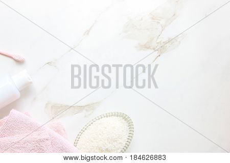 Styled self care products frame open white marble copy space