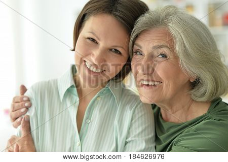 Portrait of a beautiful elderly mother with an adult daughter