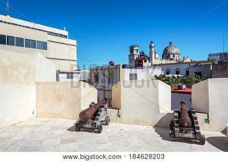 Cannons And Church In Campeche