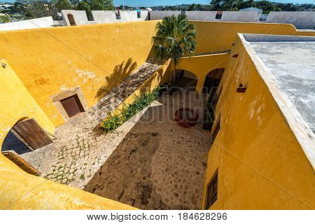 A yellow colonial fort in Campeche Mexico