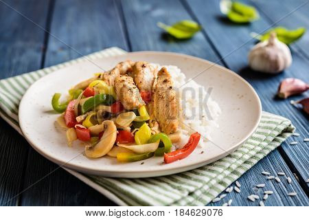 Fried Chicken Breasts Pieces Served With Steamed Vegetable And Rice