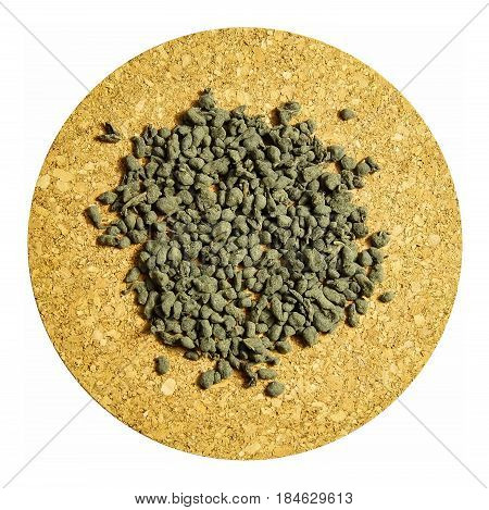 Ginseng oolong tea on a cork Board isolation