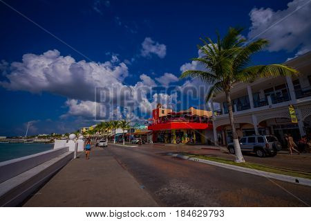 COZUMEL, MEXICO - MARCH 23, 2017: Beautiful vacation resort of Cozumel with some natural buildings, gorgeous blue ocean and sky.
