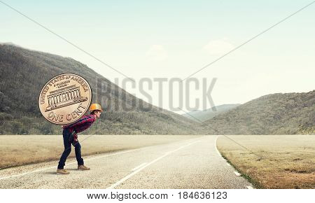 Builder man carrying on his back big cent coin