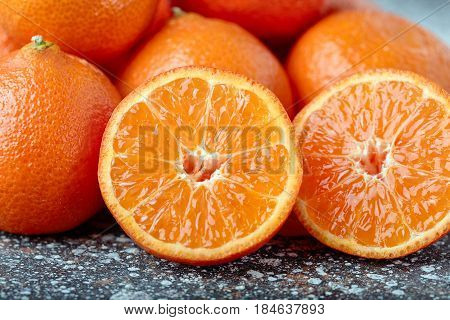 tangerine slices background closeup. tangerines on a dark background. tangerine slices