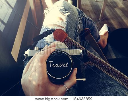 Woman Sitting With Camera Waiting Travel