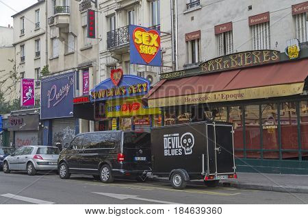 PARIS FRANCE - MARCH 31 2017: Sex shop on Boulevard de Clichy. Quartier Pigal (red light district) in Paris France. Morning everything is closed no customers.