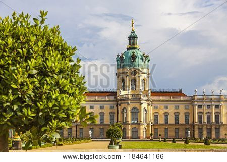 BERLIN, GERMANY - JUNE 30, 2014: Charlottenburg Palace and garden in Berlin Germany. The palace was completed in 1713 architectural style is Baroque and Rococo. The largest palace in Berlin