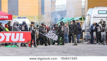 St. Petersburg Russia - 15 April, The biker is in a corner on the rear wheel,15 April, 2017. International Motor Show IMIS-2017 in Expoforurum. Sports motorcycle show of bikers on the open area.