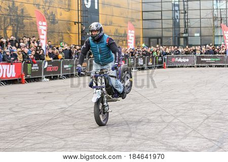 St. Petersburg Russia - 15 April, Braking on the front wheel,15 April, 2017. International Motor Show IMIS-2017 in Expoforurum. Sports motorcycle show of bikers on the open area.