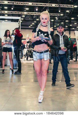 St. Petersburg Russia - 15 April, A young participant in a motor show,15 April, 2017. International Motor Show IMIS-2017 in Expoforurum. Visitors and participants of the annual moto-salon in St. Petersburg