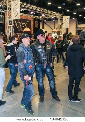 St. Petersburg Russia - 15 April, A crowd of different people at a motor show,15 April, 2017. International Motor Show IMIS-2017 in Expoforurum. Visitors and participants of the annual moto-salon in St. Petersburg