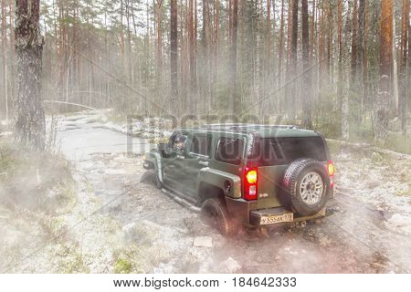 Leningrad region, Russia - April 30, 2017. Hammer H3 off-road in the Leningrad region. Hummer H3 is a compact SUV produced by GM