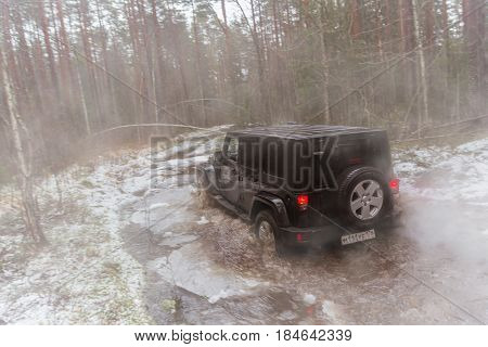 Leningrad region, Russia - April 30, 2017. Jeep Wrangler off-road in the Leningrad region. Wrangler is a compact SUV produced by Chrysler