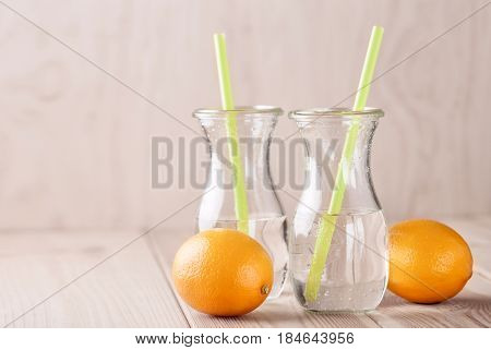 Bottle Soda with lemon on wooden background