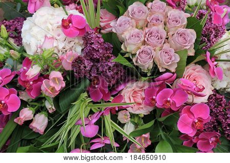 Pink and purple wedding flowers: hydrangea roses and orchids