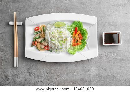 Delicious rice noodle with vegetables and meat on white plate