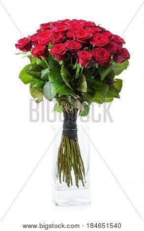 Bouquet of red roses in glass vase over white background