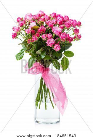 Bouquet of pink roses in glass vase over white background