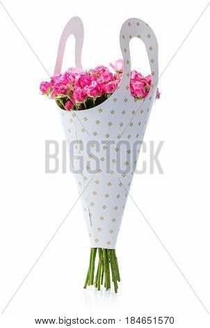 Bunch of pink roses in paper packaging over white background