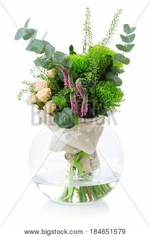 Bouquet of flowers in glass vase over white background